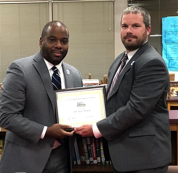 Dr. Bracy was recognized by the Board for being named a Distinguished Educator by NCASCD.