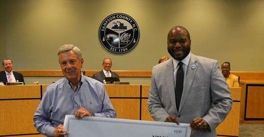 Sheriff's Department Presents School System with Check