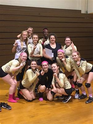 Varisty Volleyball team and coach after winning conference championship